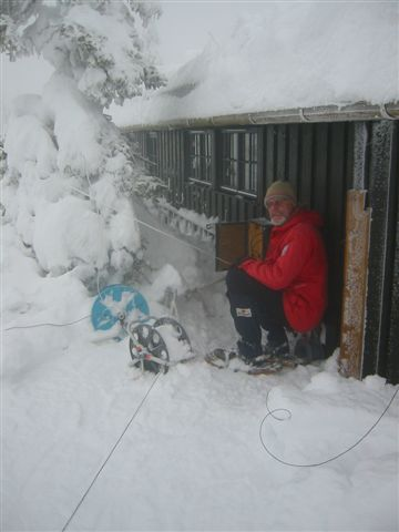 Tore checking his antennas at his cabin in the mountains, 30 kilometers north of Hamar, 800 meters above sea level, during a February 2003 venture.